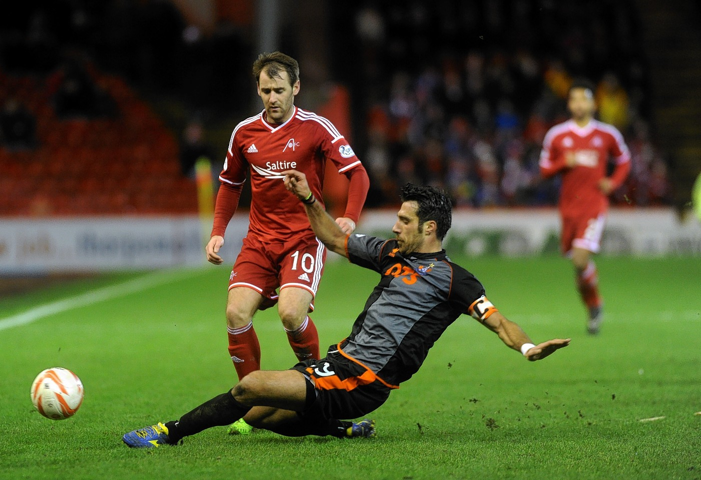 Kilmarnock defender Niall McGinn challenges Dons attacker Niall McGinn