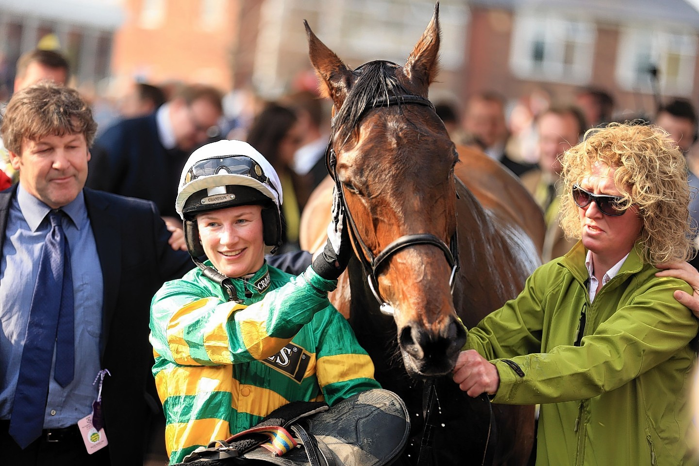 Nina Carberry celebrates after winning the Crabbie's Fox Hunters' Chase with On The Fringe on the opening day of the Crabbies Grand National Festival at Aintree