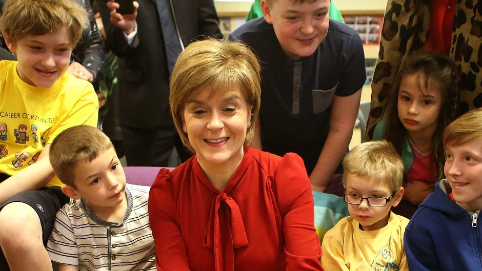 First Minister Nicola Sturgeon, visiting a school club in Loanhead, Midlothian,