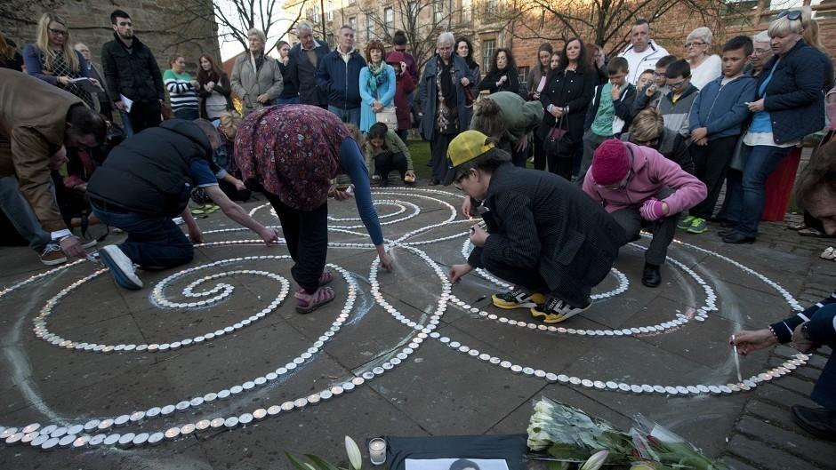People attend a vigil for Karen Buckley
