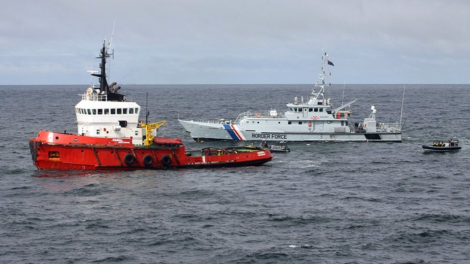 The MV Hamal, as it was intercepted by the frigate HMS Somerset and Border Force cutter Valiant about 100 miles east of the Aberdeenshire coast (NCA/PA)