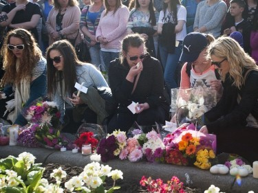 People place flowers and candles during a vigil in Glasgow for Karen Buckley
