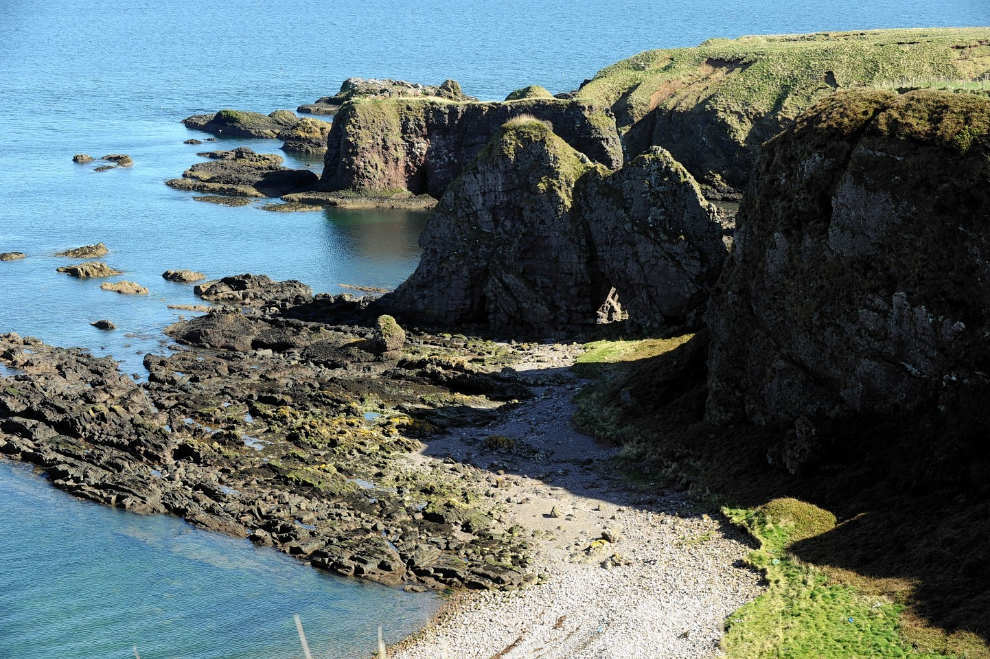 Archaeologists on top of Dunnicaer sea stack near Dunnottar Castle