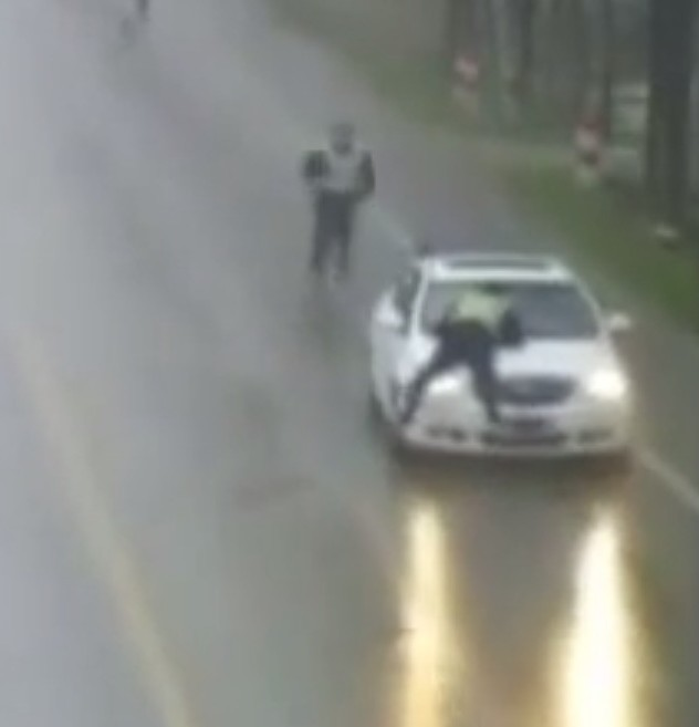The policeman was stuck on the bonnet for over half a mile