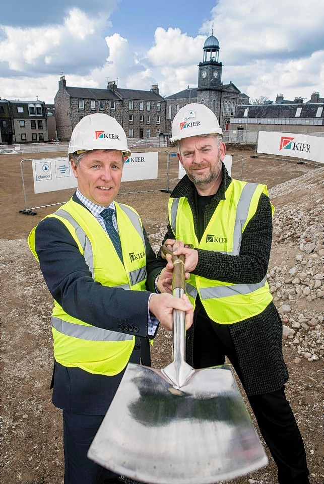 Kier's Brian McQuade and David Campbell of Alumno, prepare to break ground at Powis Place