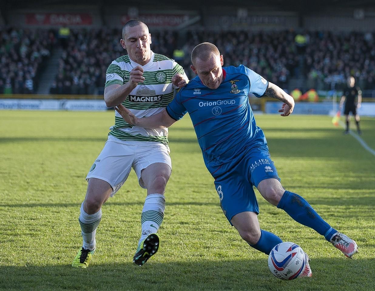Celtic captain Scott Brown challenges Caley Thistle defender Carl Tremarco