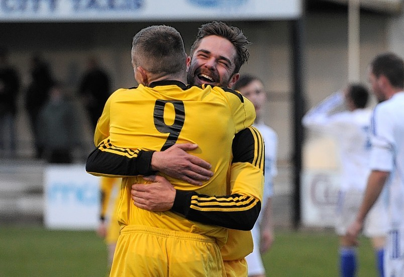 Cove's Stirling Smith and Daryl Nicol celebrate