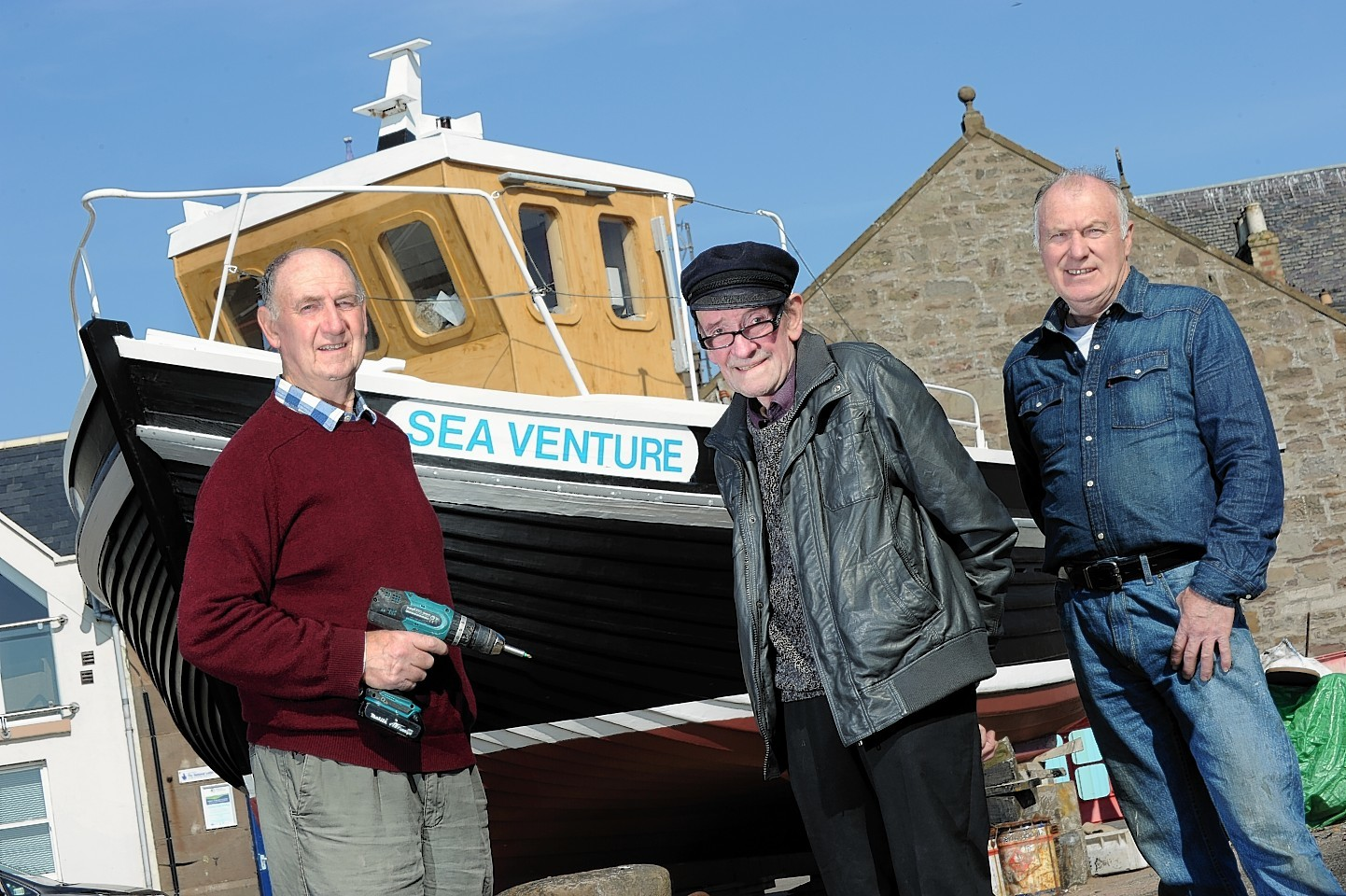 """Retired boat builders Tom Ritchie, Richard McBay and Lloyd Coates who have spent 10 years building a """"clinker"""" which is now ready to go to sea"""