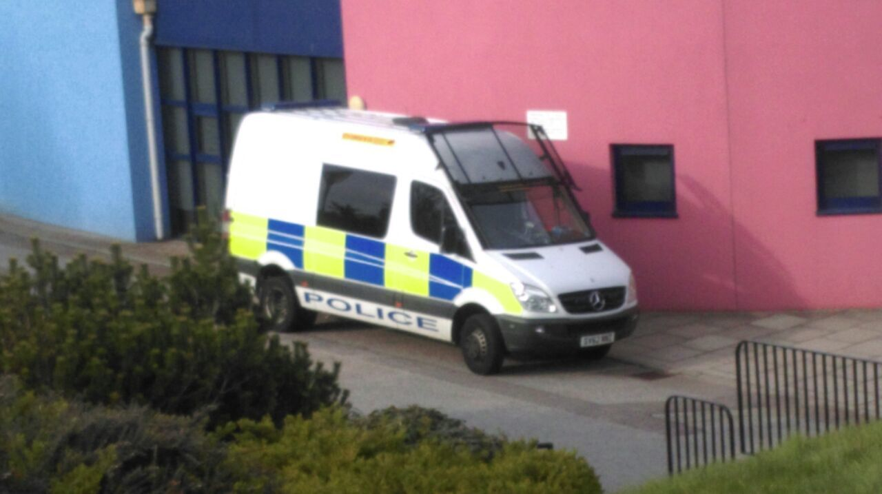 One of the police vans at the scene in Torry