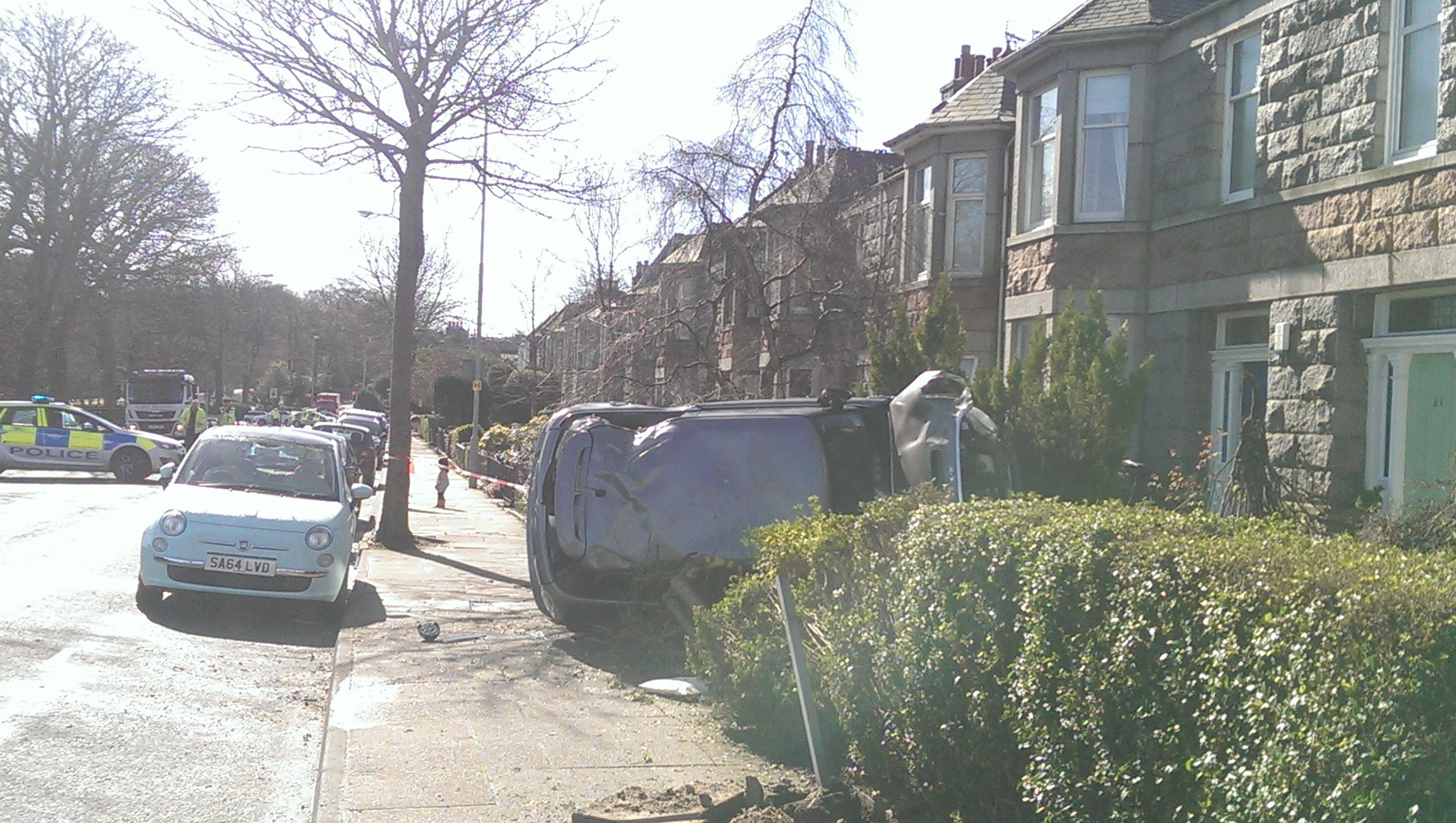 The car on its side on Westburn Drive. Credit: Martin Little.