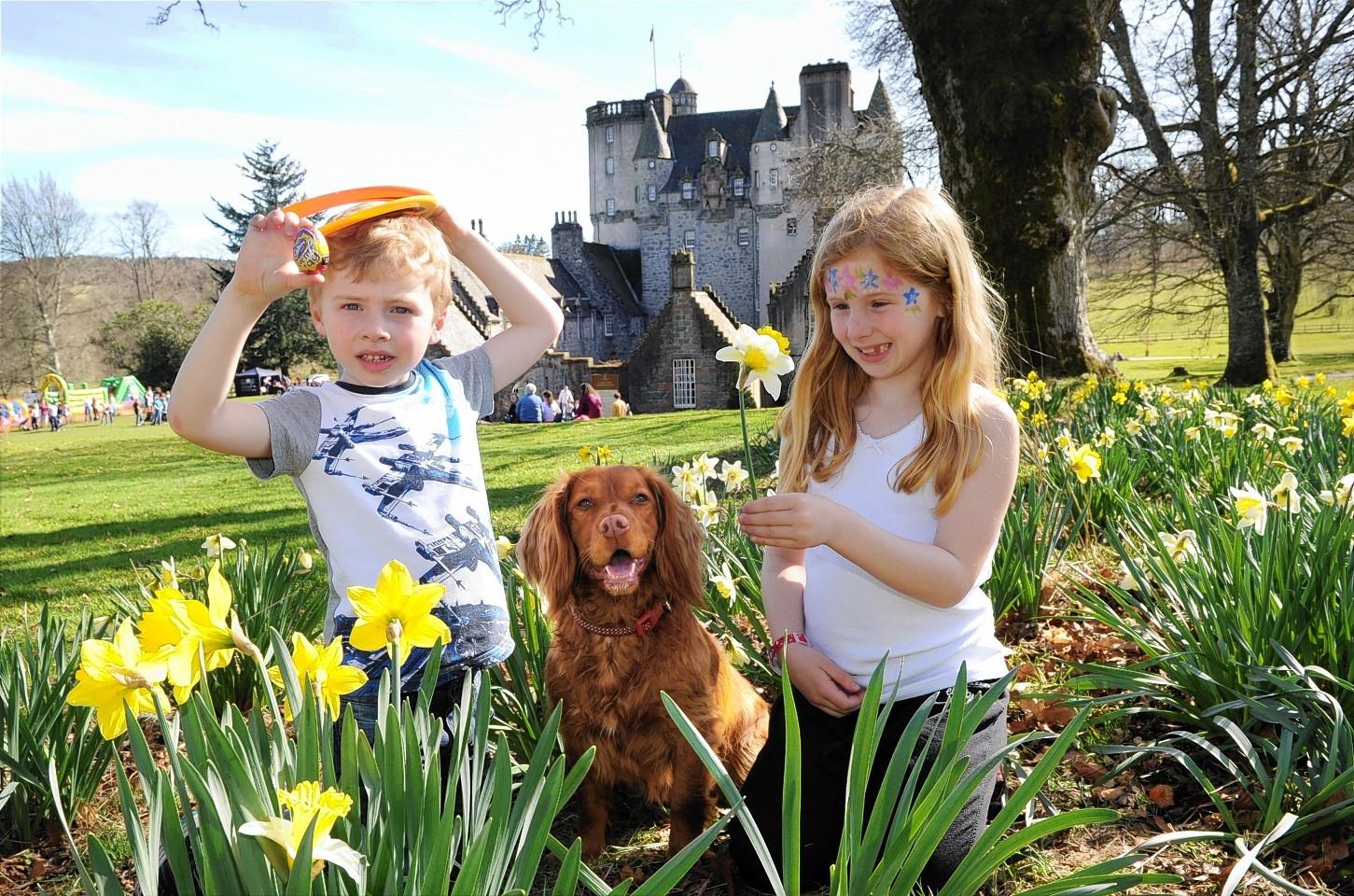 Zack and Sophie Williams enjoying the fine weather at the Castle Fraser Easter Egg Hunt.