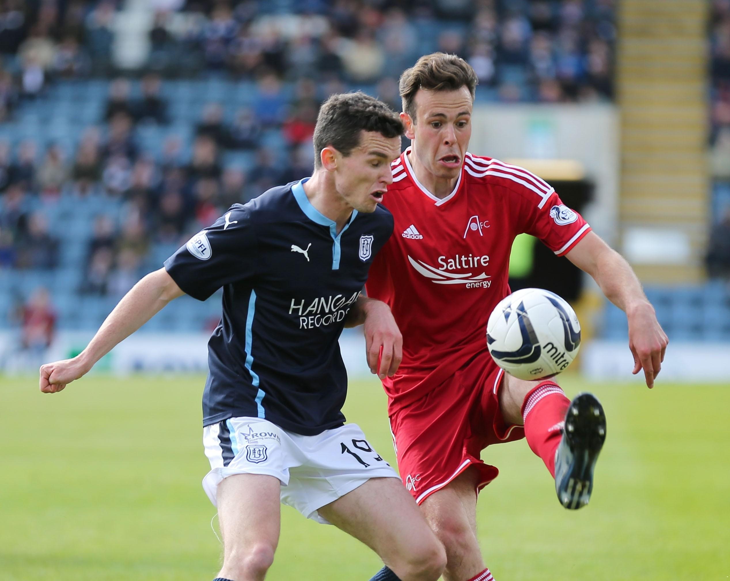 Dundee defender Paul McGinn challenges Andrew Considine