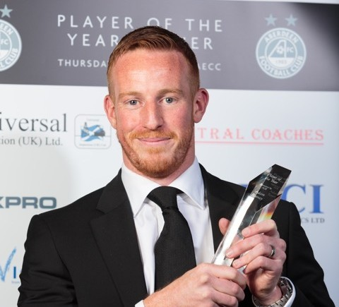 Adam Rooney with his award