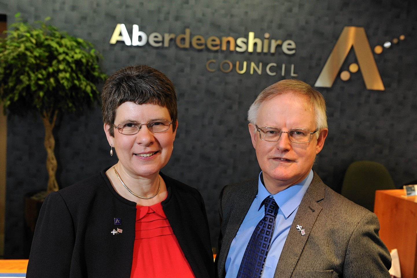 Labour councillors Alison Evison and Raymond Christie have quit Aberdeenshire Council's ruling administration