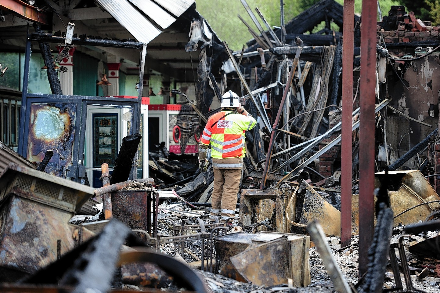 Firefighter surveys damage at the Old Royal Station, Ballater