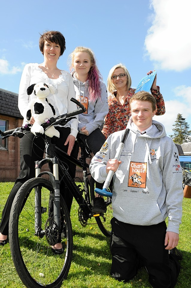 Charlie House's Tracy Johnstone and Lynn Batham with pupils Morven Douglas, 13 and Andrew Simpson, 15. Picture by Colin Rennie