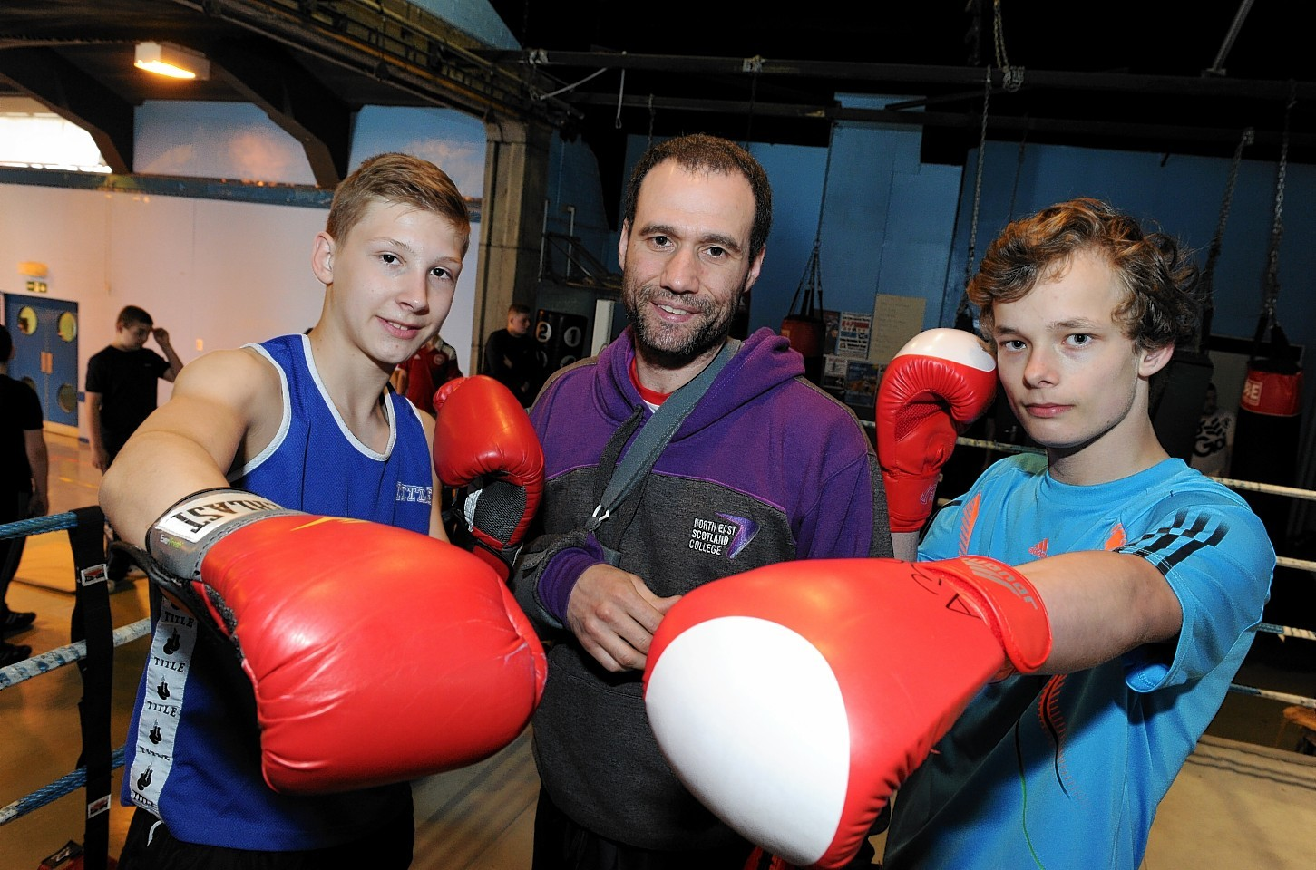 (FROM LEFT) Members of Aberdeen Boxing Club Filip Kodrzycki, head coach Leroy Smith and Mads Bendixen at Cummings Park Centre which has reopened allowing the club to start up again after two years of not having a place to train.  Picture by KEVIN EMSLIE
