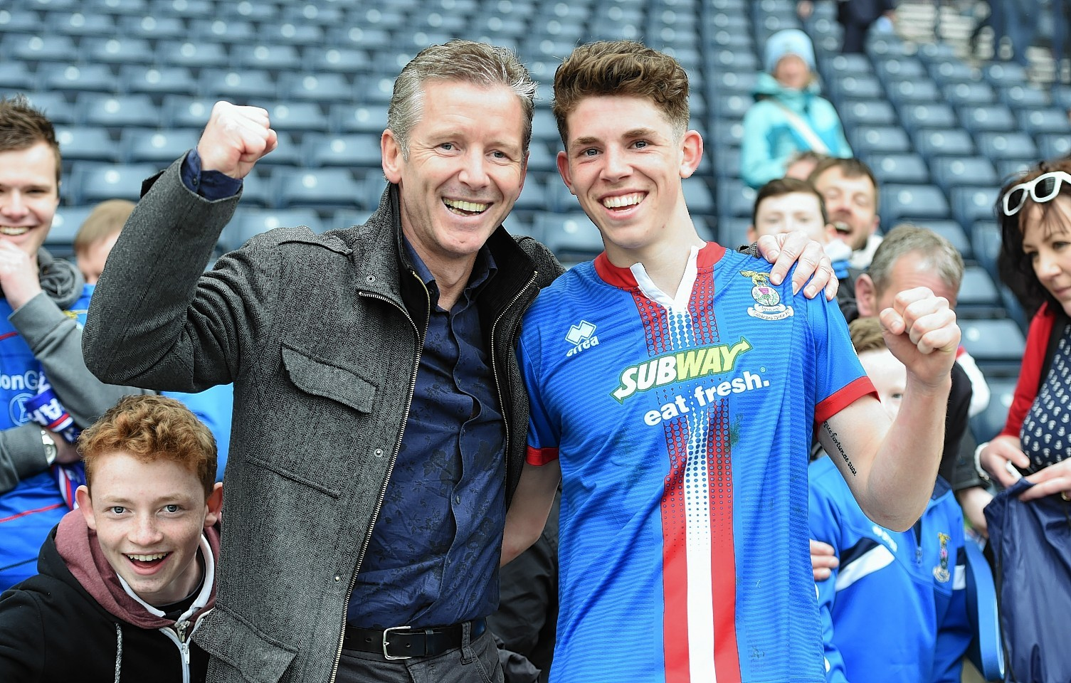 Christie Jnr celebrates with his father, Charlie