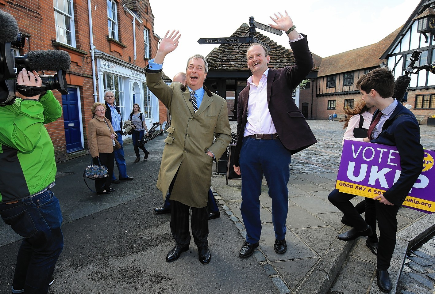 Ukip leader Nigel Farage is joined by Douglas Carswell Ukip parliamentary candidate for Clacton, while canvassing for support during a walk about in Sandwich, Ken
