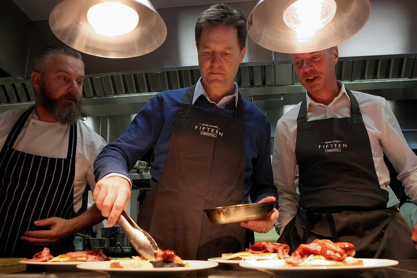 Liberal Democrats Party leader Nick Clegg  serves breakfast at Jamie Oliver's Fiftheen restaurant in Newquay, Cornwall