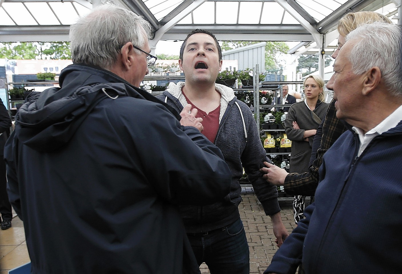 A heckler shouts during an election rally by Prime Minister David Cameron at Squires garden centre in Twickenham, London,