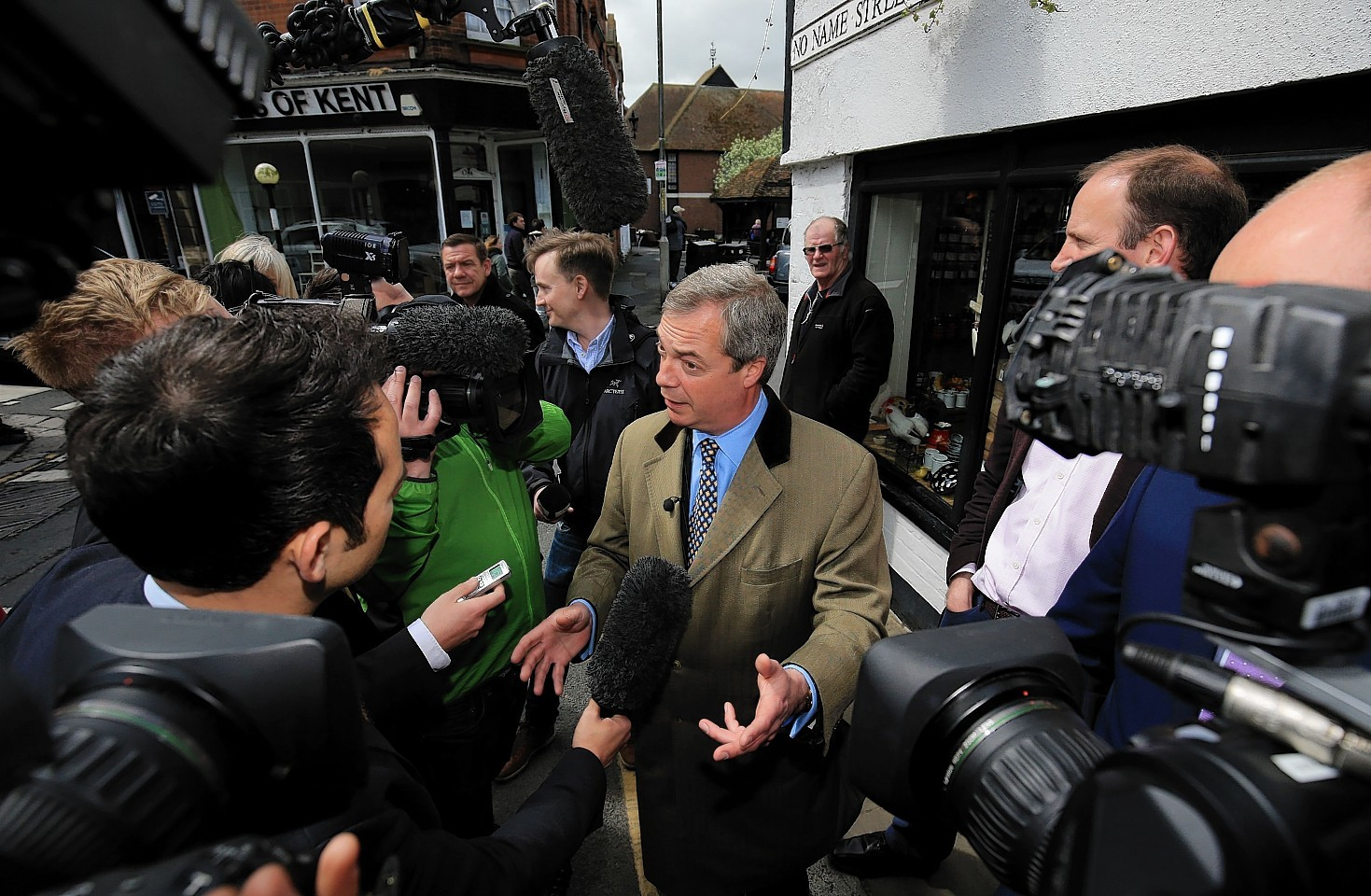 Ukip leader Nigel Farage (centre) speaking to the media while canvassing for support during a walk about in Sandwich, Kent, as he continues his campaign for the Thanet South seat in the General Election.
