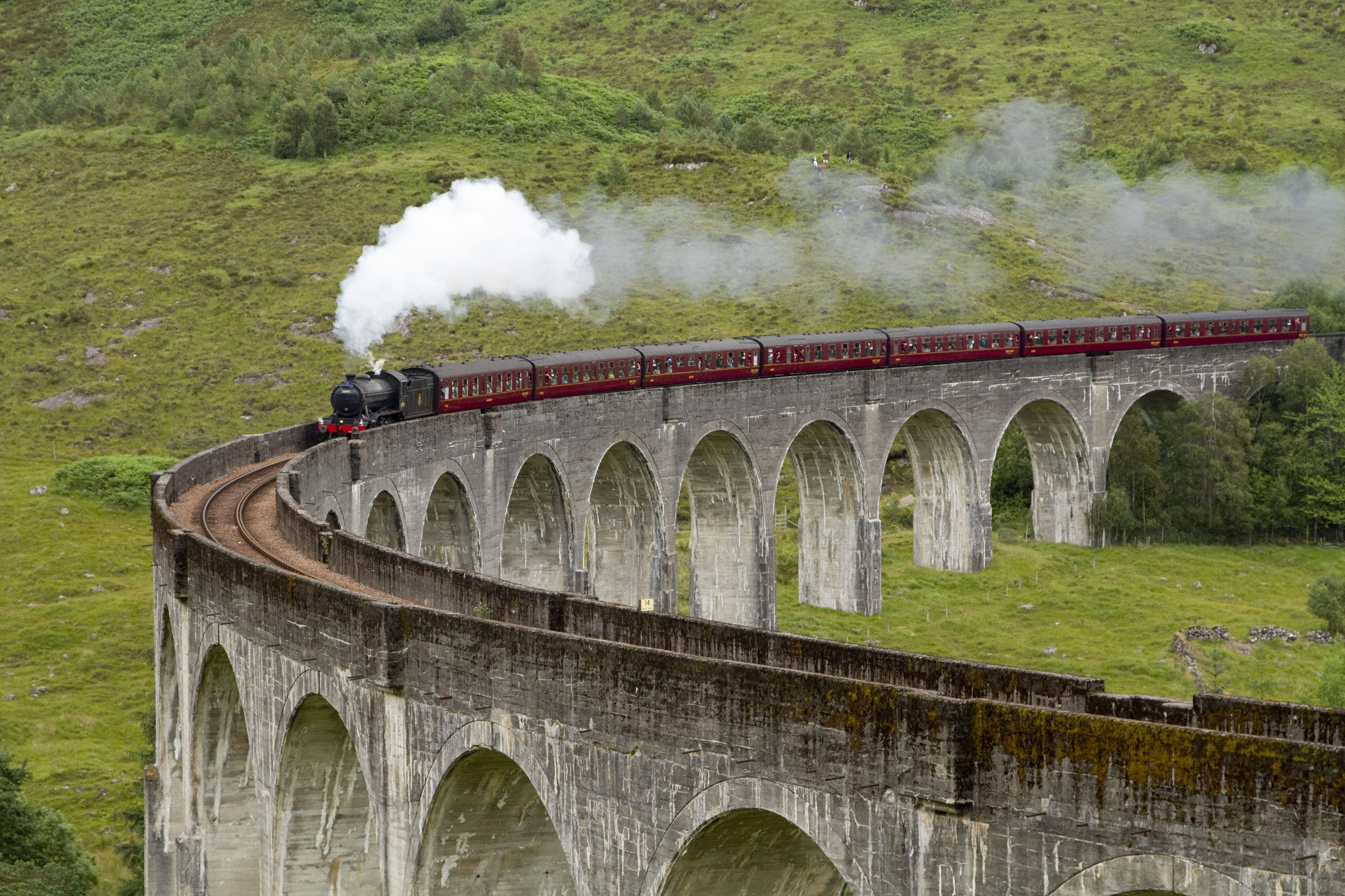 The Jacobite steam train crossing Glenfinnan Viaduct.