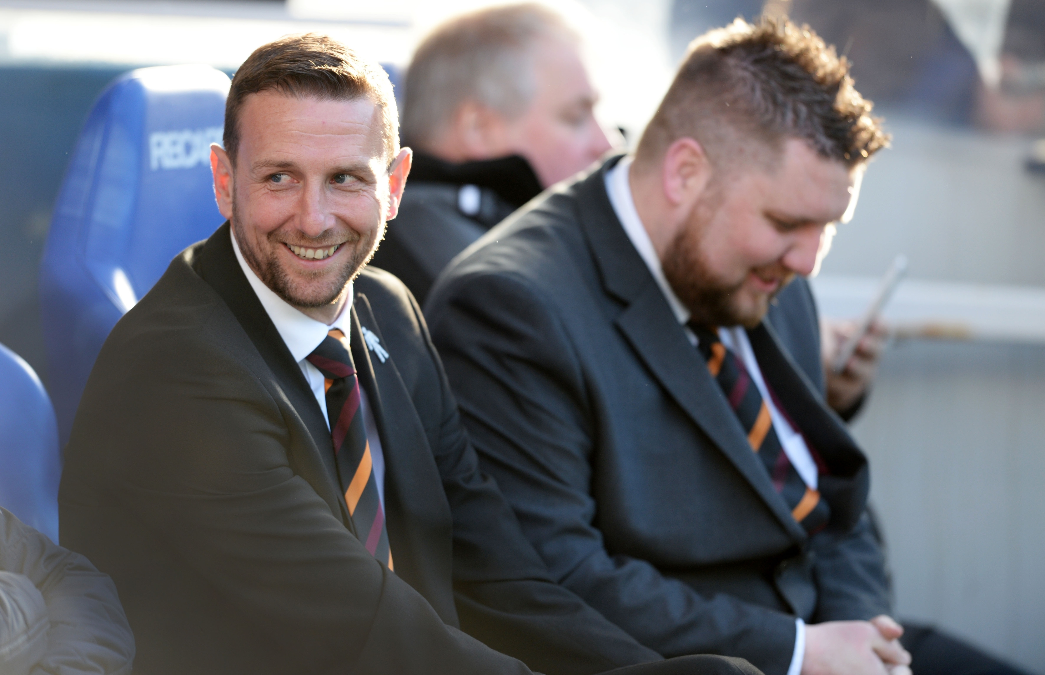 Motherwell manager Ian Baraclough sits in the dugout ahead of the match