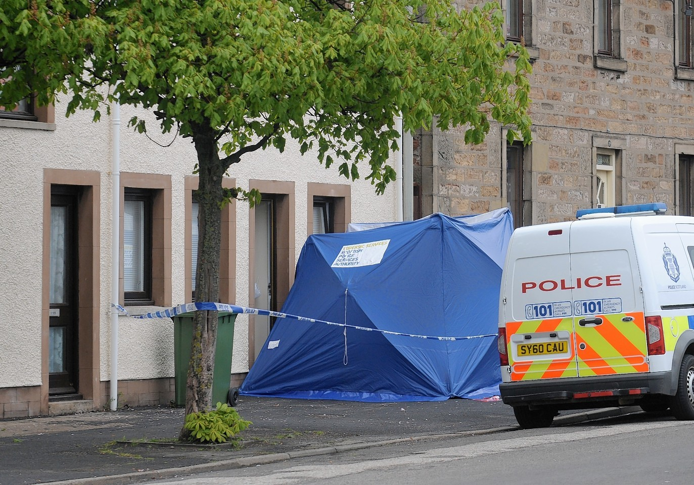 Police Scotland officers at the scene on Invergordon High Street at the incident which took place shortly before noon on Tuesday last week.