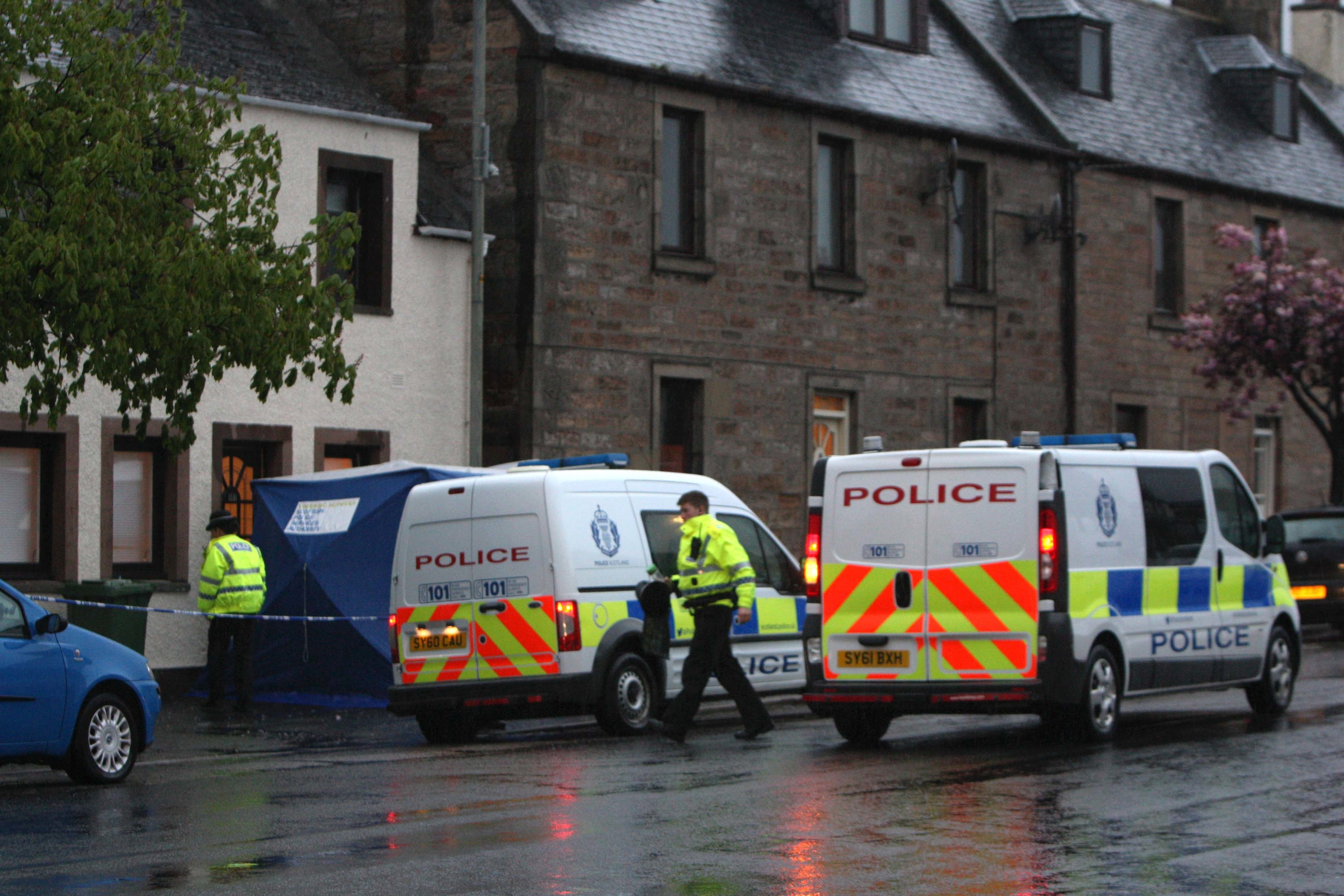Scene of a stabbing outside number 157 on the high street in Invergordon. Picture: Andrew Smith