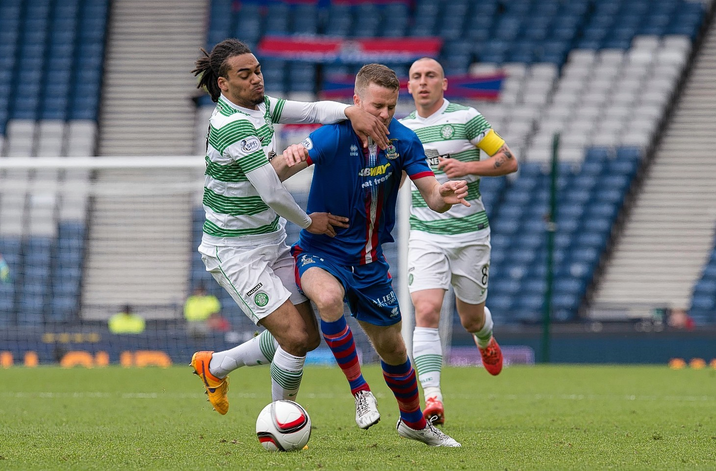 Celtic's Jason Denayer challenges Caley Thistle winger Marley Watkins