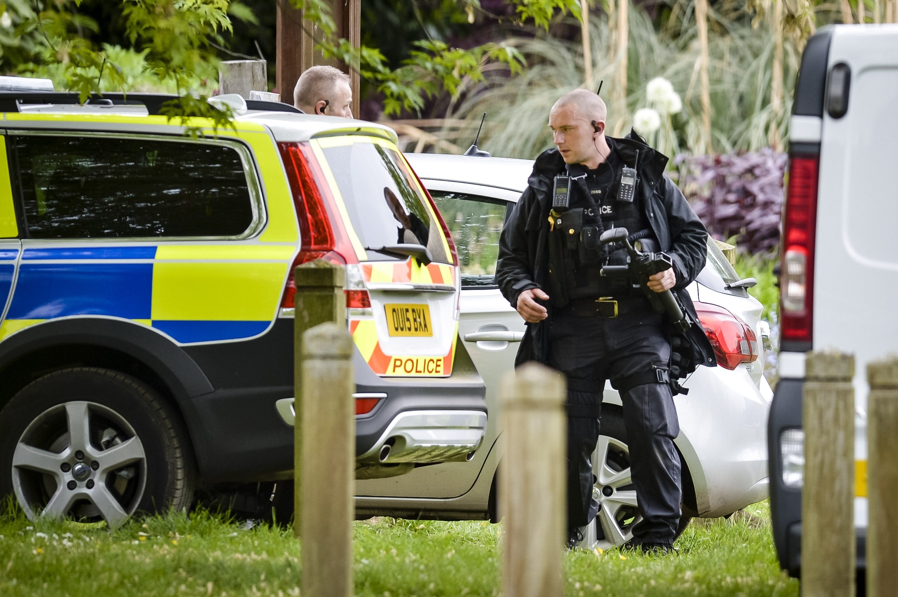 An armed police officer inside the Oxford University Parks, searching for Jed Allen