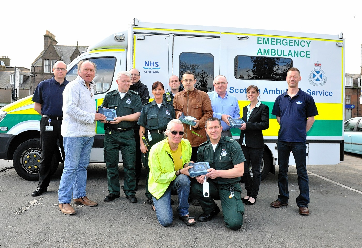 Stonehaven Community Council are receiving four defibrillators from Baker Hughes. Pictured from back left to right are Martin Fisher (baker Hughes),  Community Vice Chair Phil Mills-Bishop, John McCullough (area manager Ambulance service south grampian),Loic Gauliard (baker Hughes), Sylvia Currid (technician),Fraser Wade (Technician), Council member Daniel Veltman, Jon Shaw (baker Hughes), Lynne Anderson (community member and owner of Maggie May's Coffee Shop) and John Trudgill (baker Hughes), Front left to right are David Harper (community council) and Nick Veitch