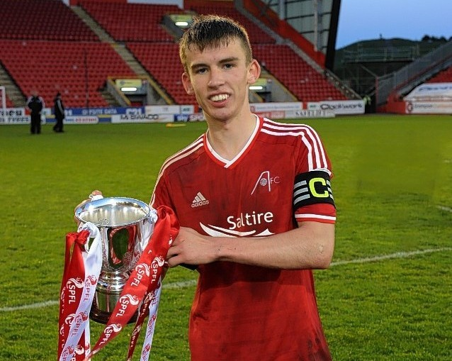 Kieran Gibbons celebrates the Dons under 20 success. Picture by Kenny Elrick