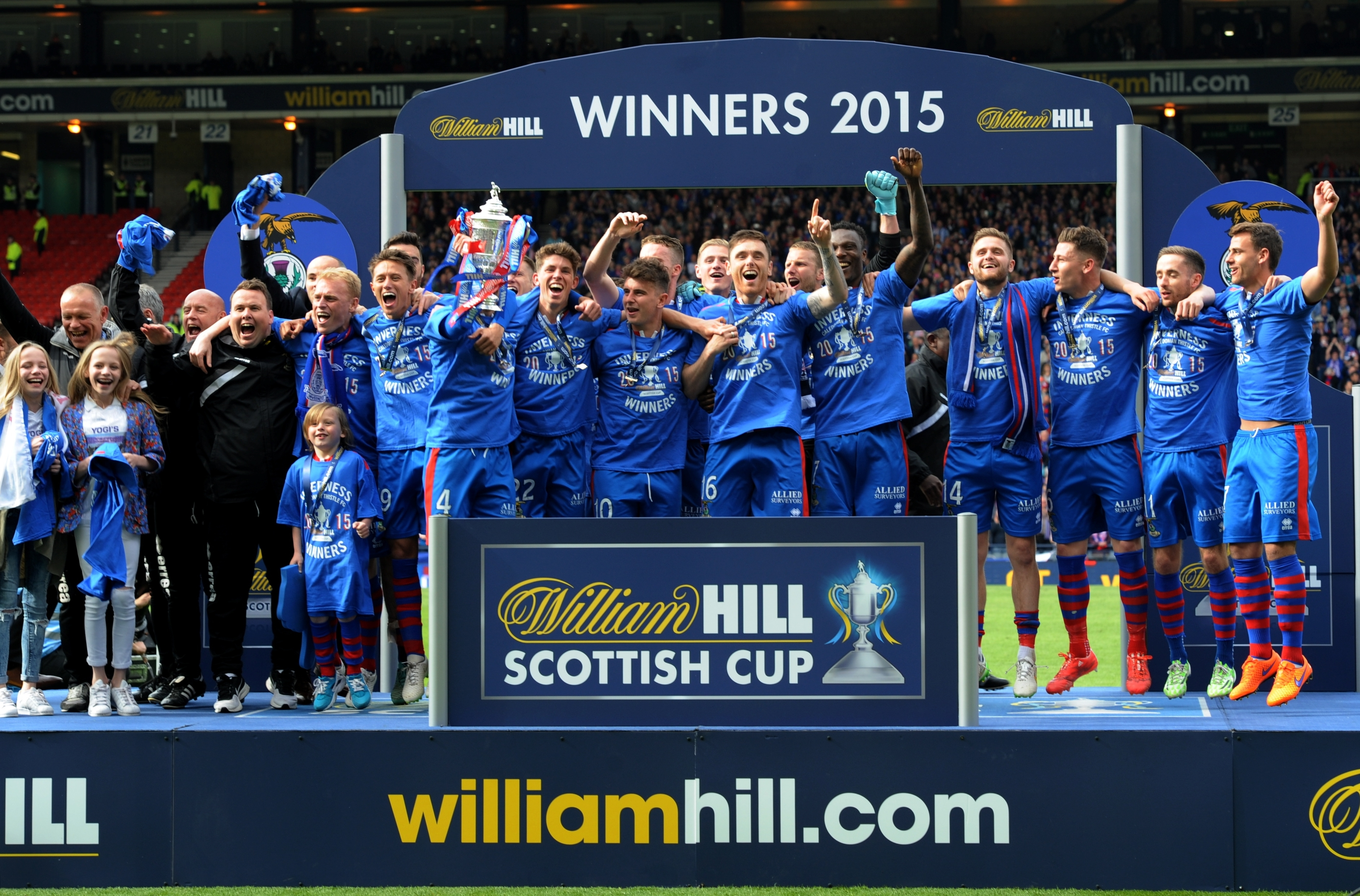 Caley Thistle lift the trophy. Picture by Kenny Elrick