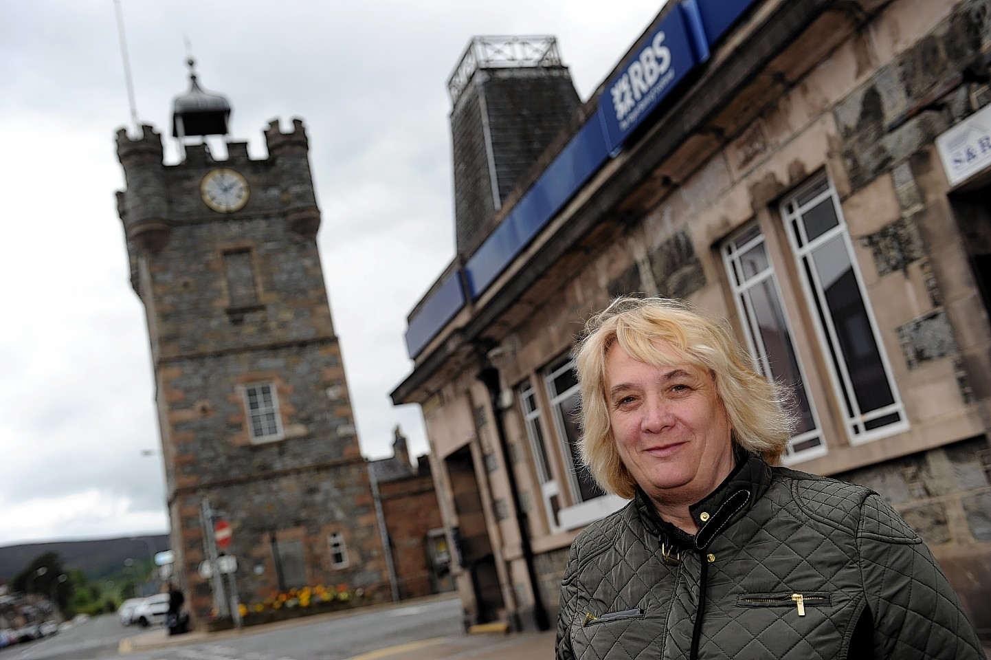 Lydia Williamson outside the now closed Royal Bank of Scotland in Dufftown.