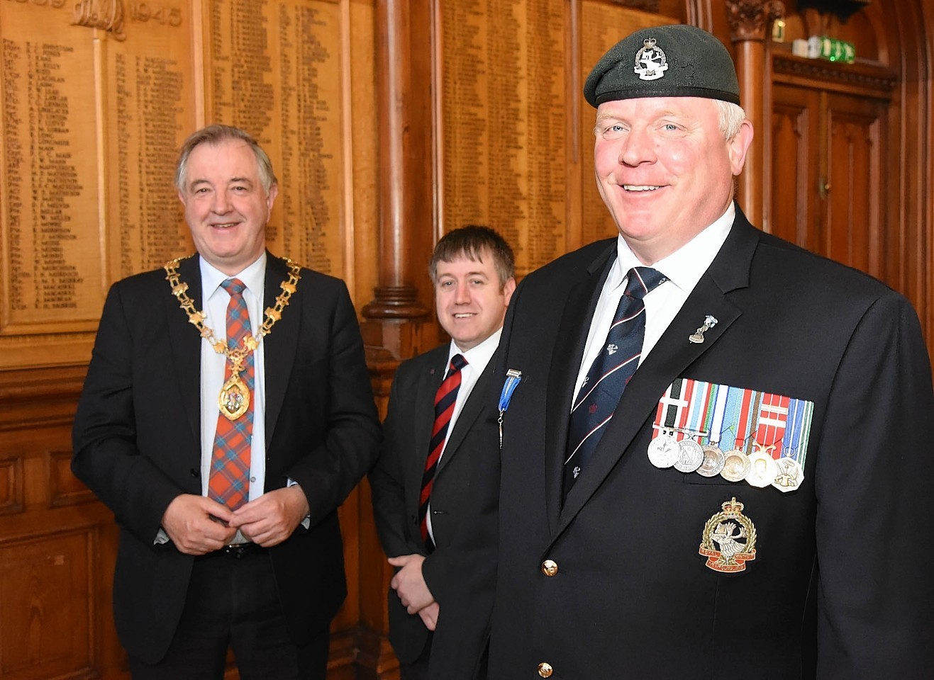 Michael Pretty of the Royal Newfoundland Regiment with Provost Alex Graham and Cllr Allan Duffy at Inverness Town House.