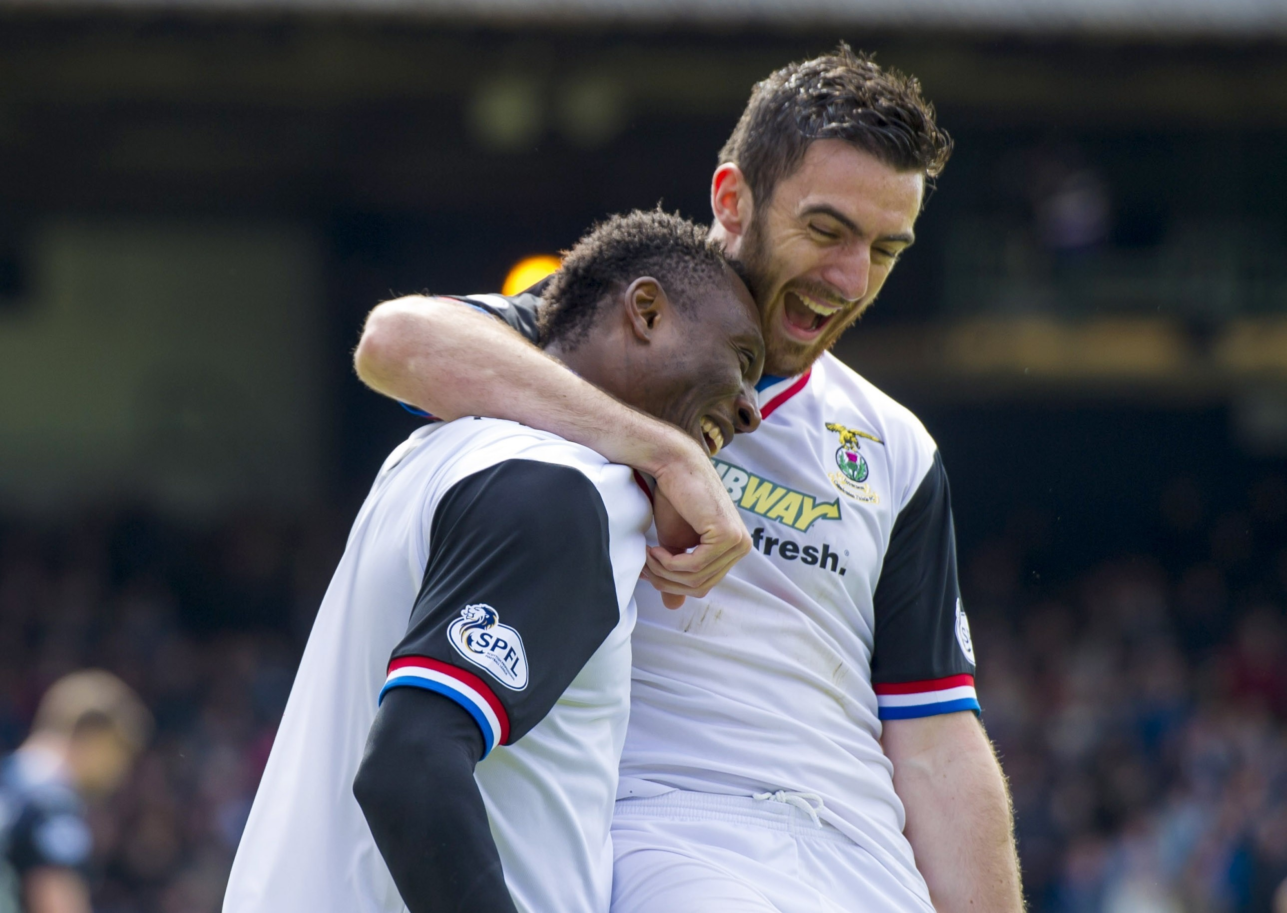 Ross Draper congratulates Eddie Ofere on his winning goal