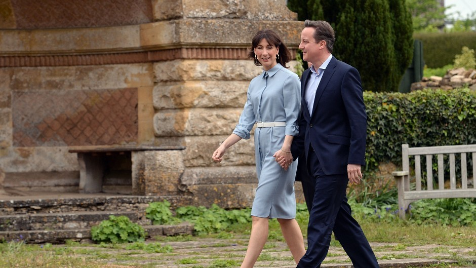 Prime Minister David Cameron and wife Samantha arrive to cast their votes at Spelsbury Memorial Hall, Witney
