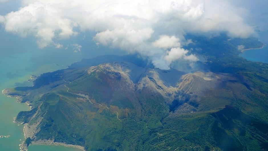 A column of smoke raises from Mount Shindake on Kuchinoerabu island, southern Japan, after it erupted.