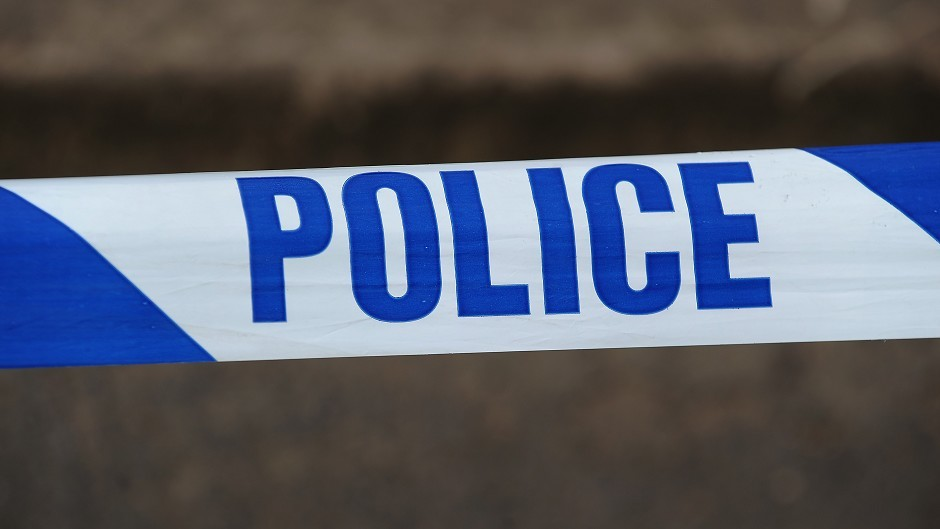 The A82 has been closed after a car land on its roof