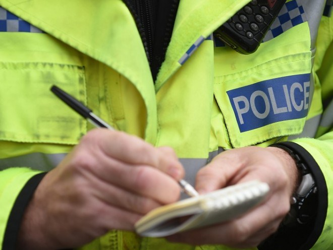 A car has overturned on its roof on the A98