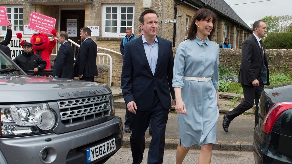 Prime Minister David Cameron and wife Samantha leave after casting their votes at Spelsbury Memorial Hall, Witney