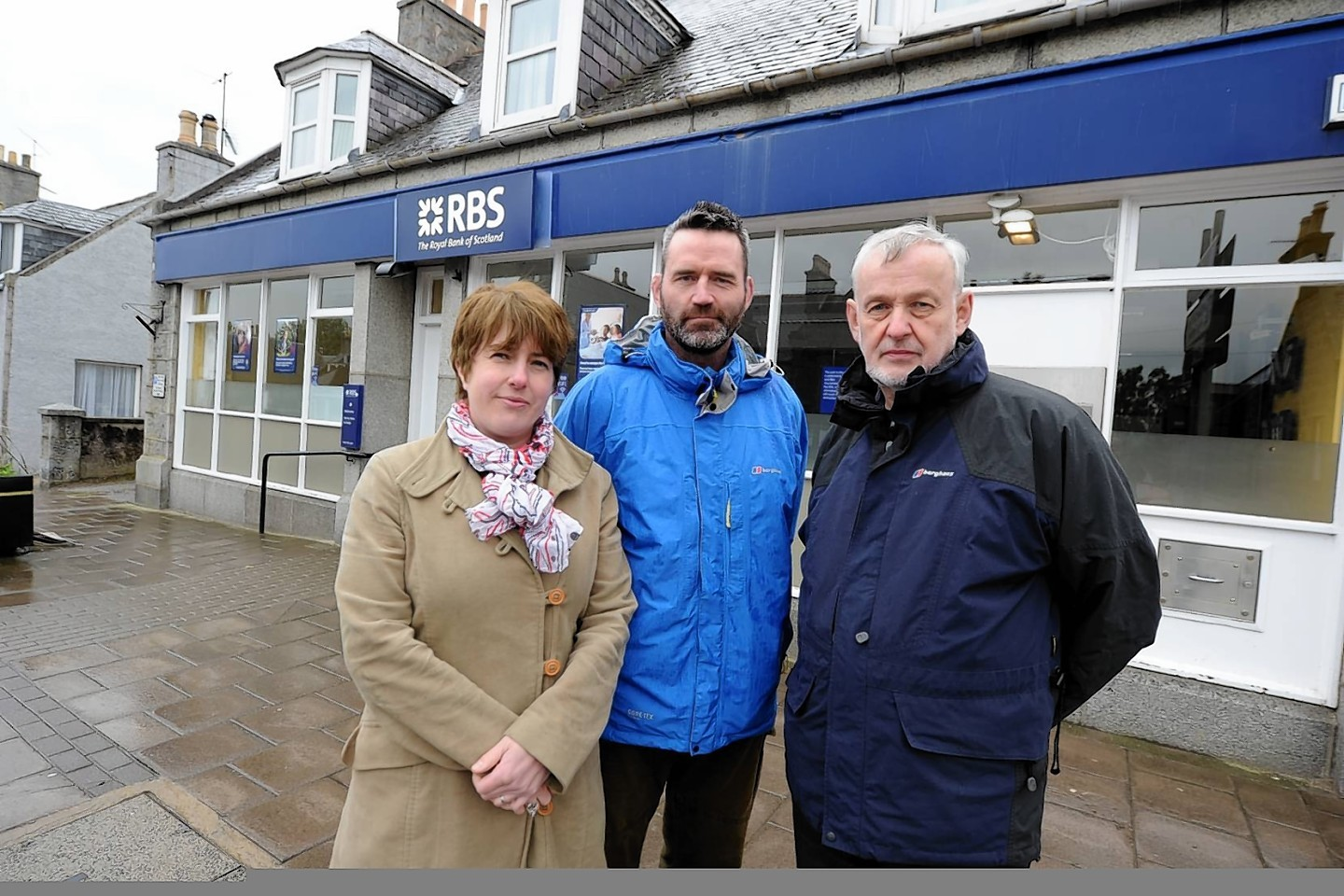 Gill Young, Pete Young and Councillor, Alastair Ross at RBS on Alford High Street.  Picture by Jim Irvine