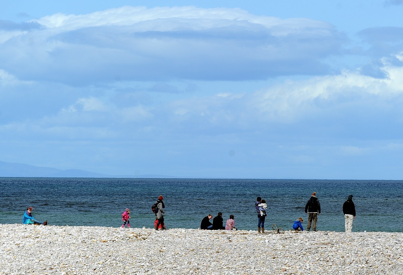 The Really Wild Festival at the Whale and Dolphin Conservation Centre at Spey Bay, Moray. Visitors to the festival look for dolphins from the beach. Picture by Gordon Lennox