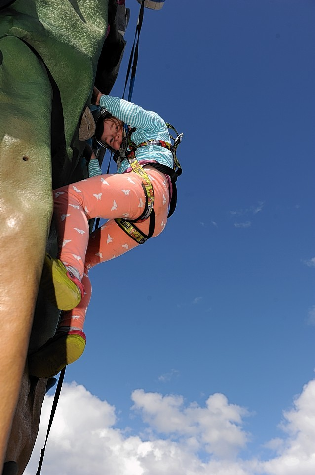 The Really Wild Festival at the Whale and Dolphin Conservation Centre at Spey Bay, Moray. Six year old Isla Ford, from Dufftown, on the climbing wall.