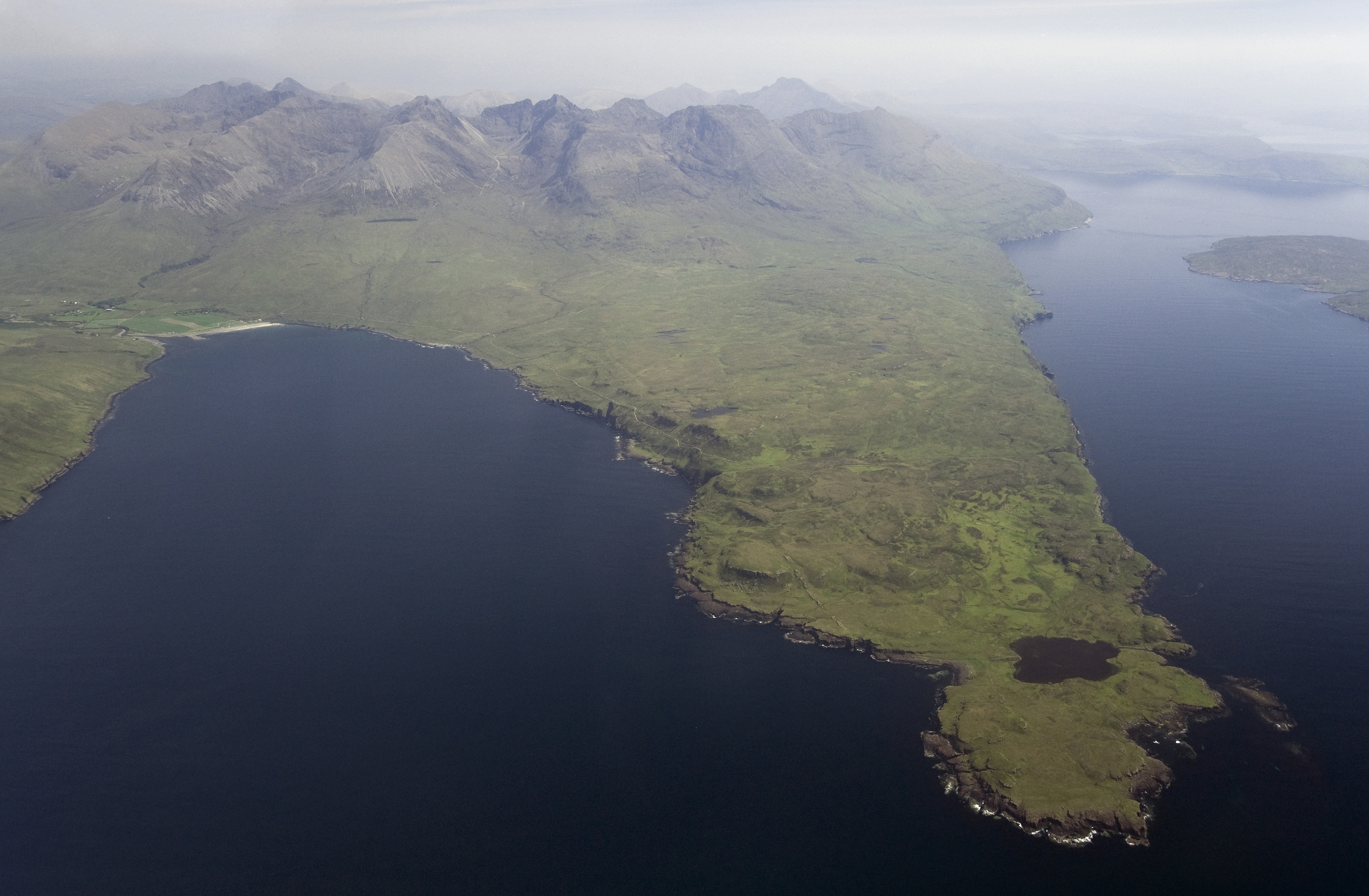 Rubh' an Dunain peninsula, Isle of Skye, showing at tip Clan MacAskill settlement and small loch connected to the sea by a man-made canal reputed to be of Viking origin.