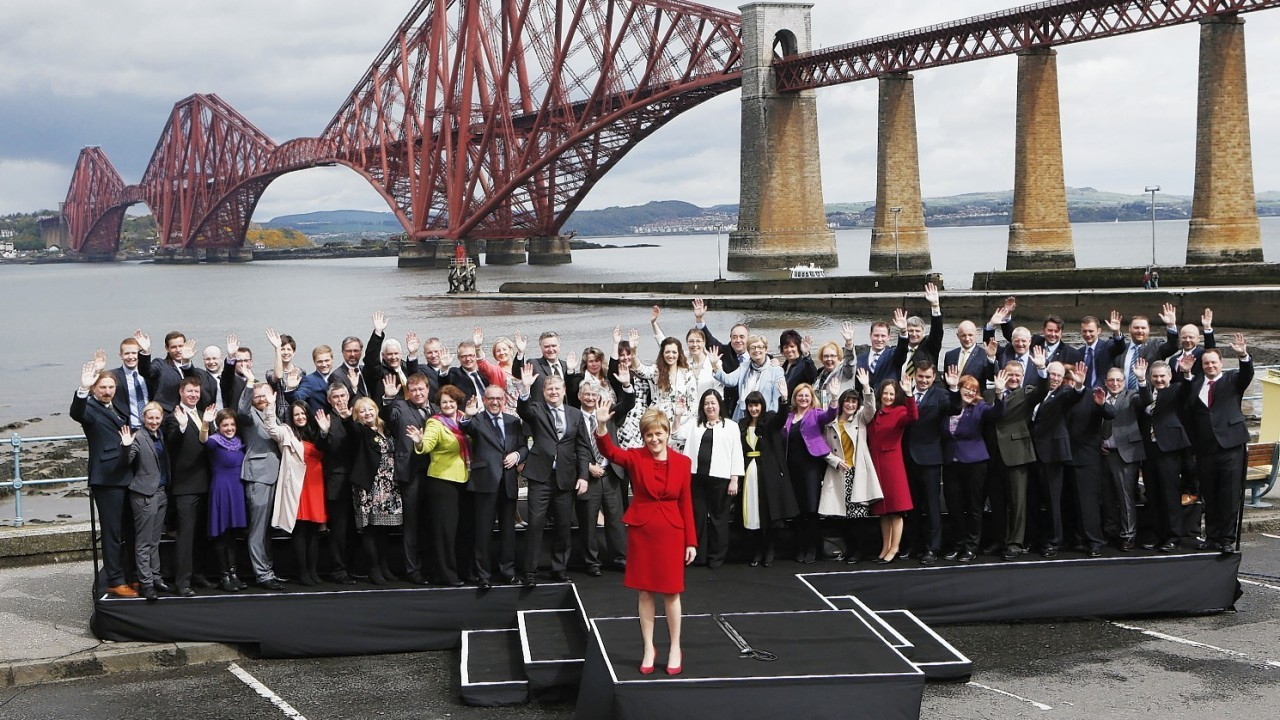 Nicola Sturgeon with the SNP's 56 MPs