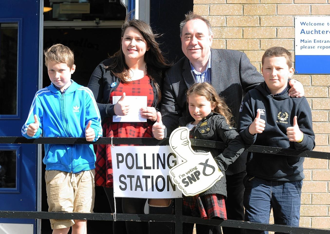 Gordon SNP candidate Alex Salmond visited Auchterellon School to vote with first-time-voter Nikki Falconer.