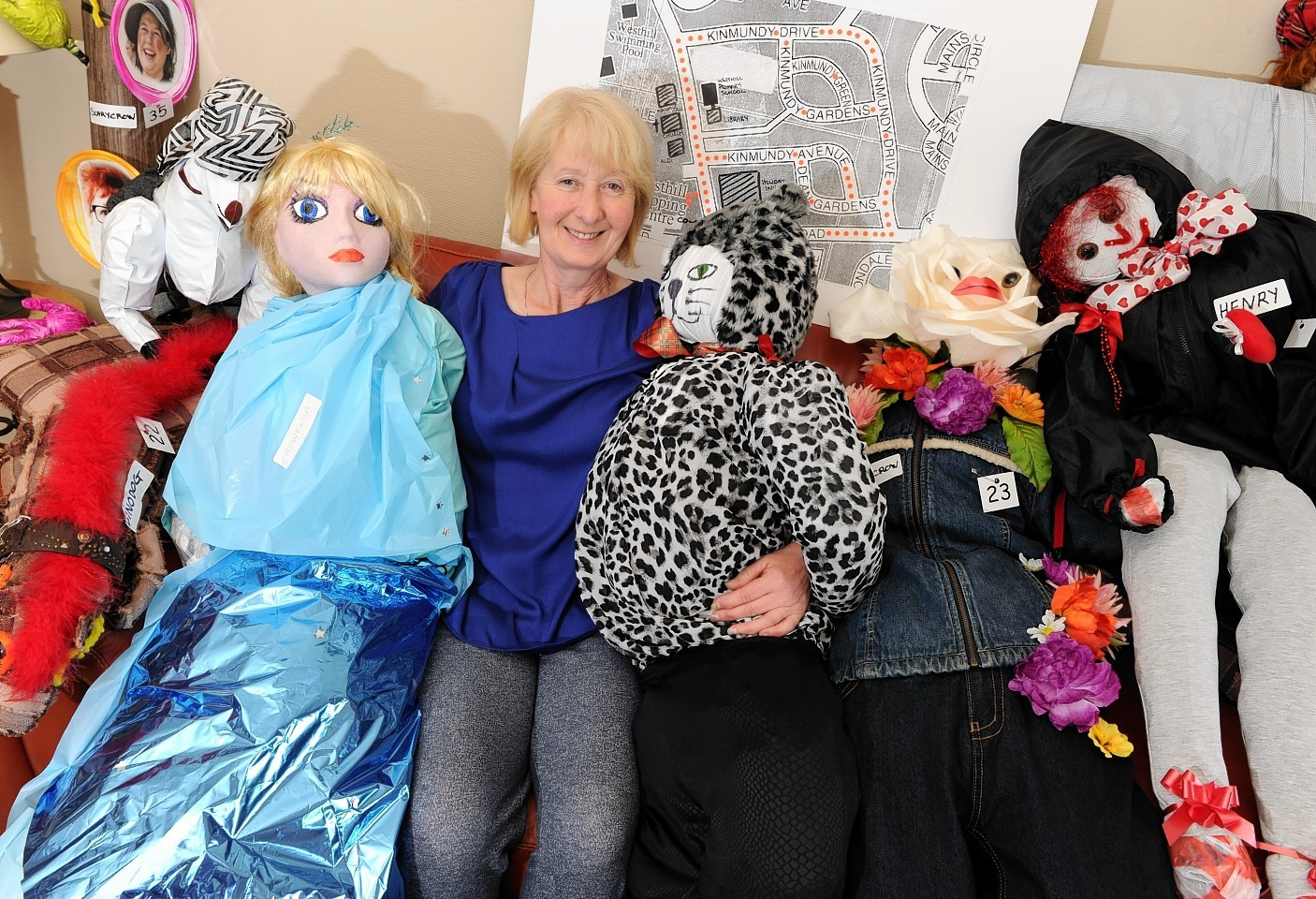 Ann Westwood with scarecrows she has made for a scarecrow trail set up in Westhill this weekend for the village gala. Picture by KEVIN EMSLIE